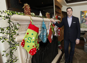 Photo - Simon Shingleton, a Realtor with Keller Williams Elite, shows this house for sale at 16708 Rugosa Rose Drive in the Rose Creek addition in northwest Oklahoma City. It is decked for Christmas. <strong>PAUL HELLSTERN - The Oklahoman</strong>
