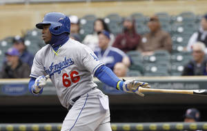 Photo - Los Angeles Dodgers' Yasiel Puig releases the bat after hitting a single to center field off Minnesota Twins starting pitcher Mike Pelfrey during the first inning in the first baseball game of a doubleheader in Minneapolis, Thursday, May 1, 2014. The Dodgers won 9-4.(AP Photo/Ann Heisenfelt)