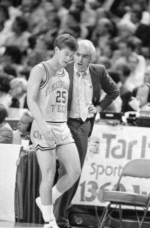 Photo - Georgia Tech's Mark Price, 25, listens to coach Bobby Cremins during Saturday, March 9, 1985 game against Duke played at the Omni in Atlanta, Ga. Price scored 24 points to lead the Yellow Jackets to a 75-64 win. (Ap Photo/Bob Jordan)