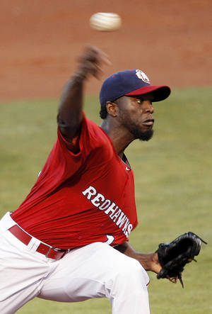 Photo - Oklahoma City's Henry Sosa (19) pitches during a minor league baseball game between the Oklahoma City RedHawks and the Round Rock Express at Chickasaw Bricktown Ballpark in Oklahoma City, Thursday, April 26, 2012. Photo by Nate Billings, The Oklahoman