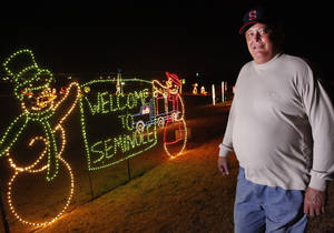 Photo - Neil Craig is at the Snowman Wonderland in Seminole. Craig, a resident of Seminole for 33 years, is leading the community display effort.  Photo By David McDaniel, The Oklahoman