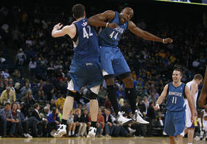 Photo -   Minnesota Timberwolves' Kevin Love (42) and Anthony Tolliver (44) celebrate against the Golden State Warriors during the fourth quarter of an NBA basketball game in Oakland, Calif., Monday, March 19, 2012. The Timberwolves won 97-93. (AP Photo/Jeff Chiu)