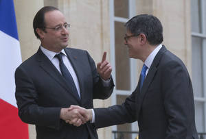 Photo - France's President Francois Hollande, left, welcomes U.S. Treasury Secretary Jack Lew at the Elysee Palace in Paris, Tuesday, Jan. 7, 2014. Lew is on a European tour for two days. (AP Photo/Michel Euler)