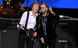 Photo - FILE - This April 4, 2009 file photo shows Paul McCartney, left, and Ringo Starr performing at the Change Begins Within Concert in New York. The Recording Academy announced Tuesday, Jan 14, 2014, that both McCartney and Starr will perform at the Jan. 26 Grammy awards show. The Beatles will be honored at the Academy's Special Merits Awards a day before, and a day after the big show, the iconic group will be the center of a performance special featuring Eurythmics and other acts playing Beatles hits. (AP Photo/Stephen Chernin, File)