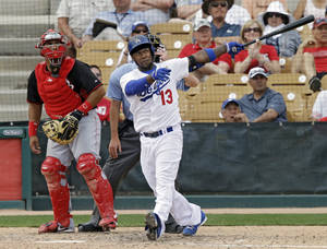 Photo - Los Angeles Dodgers' Hanley Ramirez (13) watches his solo home run with Cincinnati Reds catcher Brayan Pena in the fifth inning of a spring exhibition baseball game on Thursday, March 13, 2014, in Glendale, Ariz. (AP Photo/Mark Duncan)