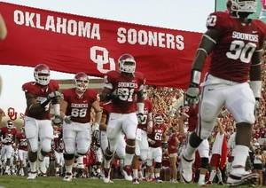 photo - The Oklahoma football team takes the field before the college football game between the University of Oklahoma Sooners ( OU) and the Tulsa University Hurricanes (TU) at the Gaylord Family-Memorial Stadium on Saturday, Sept. 3, 2011, in Norman, Okla. Photo by Bryan Terry, The Oklahoman ORG XMIT: KOD