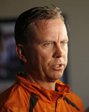 Photo - COLLEGE FOOTBALL: Offensive coordinator Todd Monken speaks to the media during the OSU spring football press conference at Boone Pickens Stadium on the campus of Oklahoma State University in Stillwater, Okla., Monday, March 12, 2012. Photo by Nate Billings, The Oklahoman
