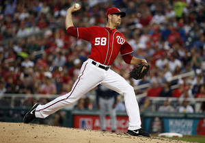 Photo - Washington Nationals starting pitcher Doug Fister throws during the third inning of a baseball game against the Atlanta Braves at Nationals Park on Saturday, June 21, 2014, in Washington. (AP Photo/Alex Brandon)