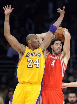 Photo -   Los Angeles Lakers guard Kobe Bryant (24) and Houston Rockets forward Luis Scola (4), of Argentina, battle for possession in the first half of an NBA basketball game, Friday, April 6, 2012, in Los Angeles. (AP Photo/Gus Ruelas)