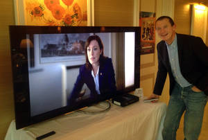 """Photo - Neil Hunt, Netflix's chief product officer, demonstrates ultra high definition streaming of a """"House of Cards"""" trailer on a Sony TV on the sidelines of the International Consumer Electronics Show in Las Vegas. (AP Photo/Ryan Nakashima) <strong>Ryan Nakashima</strong>"""