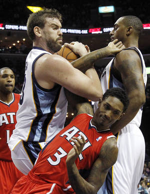 photo - Memphis Grizzlies forward Rudy Gay (22) fights for a loose ball with Atlanta Hawks guard Louis Williams (3) in the first half of an NBA basketball game on Saturday, Dec. 8, 2012, in Memphis, Tenn. (AP Photo/Lance Murphey)