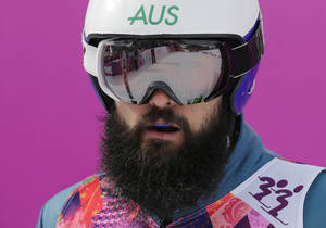 Photo - Australia's Anton Grimus waits after his seeding run in the men's ski cross at the Rosa Khutor Extreme Park, at the 2014 Winter Olympics, Thursday, Feb. 20, 2014, in Krasnaya Polyana, Russia. (AP Photo/Andy Wong)