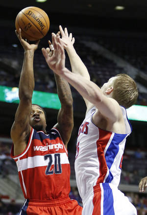 photo - CORRECT DATE -Washington Wizards forward Cartier Martin (20) takes a shot against Detroit Pistons forward Kyle Singler (25) in the first half of an NBA basketball game in Auburn Hills, Mich., Friday, Dec. 21, 2012. (AP Photo/Duane Burleson)