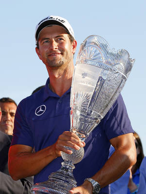 Photo - Adam Scott, of Australia, holds the trophy after winning The Barclays golf tournament on Sunday, Aug. 25, 2013, in Jersey City, N.J. (AP Photo/Rich Schultz)