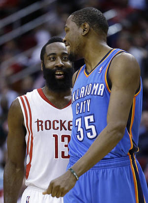 Photo - Houston Rockets' James Harden (13) talks to Oklahoma City Thunder's Kevin Durant (35) before Durant's free throws during the second quarter of an NBA basketball game Thursday, Jan. 16, 2014, in Houston. (AP Photo/David J. Phillip)