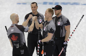 Photo - Canada's men's curling team as seen from left to right, Ryan Fry, E.J. Harnden, Brad jacobs and Ryan Harnden celebrate after beating China in the men's curling semifinal game at the 2014 Winter Olympics, Wednesday, Feb. 19, 2014, in Sochi, Russia. (AP Photo/Wong Maye-E)