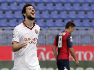 Photo - Roma's Mattia Destro celebrates after scoring during a Serie A soccer match between Cagliari and Roma in Cagliari, Italy, Sunday, April 6, 2014. Roma moved within five points of Serie A leader Juventus as Mattia Destro scored his first-ever hat trick in a 3-1 win at Cagliari on Sunday. (AP Photo/Max Solinas)