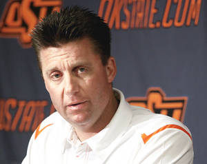 Photo - Oklahoma State coach Mike Gundy talks to the media Saturday in Stillwater.  (Photo by John Clanton, The Oklahoman)