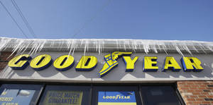 Photo - In this Wednesday, Feb. 12, 2014 photo shows  icycles hanging above a Goodyear sign in South Euclid, Ohio. Goodyear reports quarterly earnings on Thursday, Feb. 13, 2014. (AP Photo/Tony Dejak)