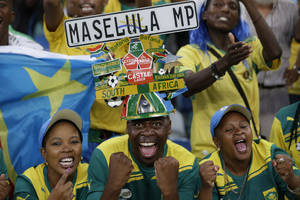 photo - South Africa fans cheer after their team defeated Angola 2-0 in their African Cup of Nations Group A soccer match at Moses Mabhida Stadium in Durban, South Africa, Wednesday, Jan. 23, 2013. (AP Photo/Rebecca Blackwell)