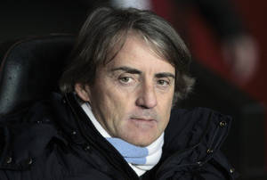 photo - Manchester City's manager Roberto Mancini looks on from the dugout before the start of their English Premier League soccer match against Southampton at St Mary's stadium, Southampton, England, Saturday, Feb. 9, 2013. (AP Photo/Sang Tan)
