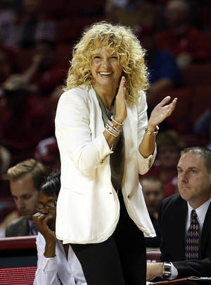 Photo - Oklahoma head coach Sherri Coale laughs during the first half of an NCAA college basketball game against Creighton in Norman, Okla., Sunday, Dec. 1, 2013. (AP Photo/Garett Ray Fisbeck)