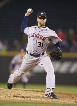 Photo - Houston Astros starter Collin McHugh delivers a pitch in the seventh inning of a  baseball game against the Seattle Mariners, Tuesday, April 22, 2014, in Seattle. (AP Photo/Stephen Brashear)