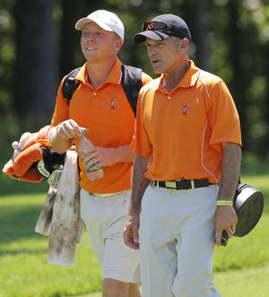 Photo - OSU coach Mike McGraw, right, talks with Talor Gooch during the semifinals of the 2011 NCAA Division I Men's Golf Championship at Karsten Creek in Stillwater. PHOTO BY NATE BILLINGS, The Oklahoman Archives