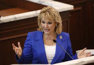 Photo - Oklahoma Gov. Mary Fallin delivers her State of the State address to lawmakers Monday afternoon, Feb. 4, 2013, in the House of Representatives chamber. Also attending were members of the governor's cabinet and members of the judiciary. Photo by Jim Beckel, The Oklahoman