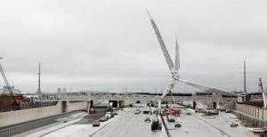photo - The unfinished Skydance Bridge is shown spanning the also unfinished new Interstate 40 on Wednesday in Oklahoma City. The freeway should be open at least in part by next month, and construction on the pedestrian bridge should be finished by late spring. &lt;strong&gt;PAUL B. SOUTHERLAND - The Oklahoman&lt;/strong&gt;