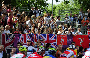 Photo -   In this Saturday July 28, 2012 photo, spectators cheer as the men's cycling road race starts on the Mall in London during the 2012 Summer Olympics. (AP Photo/John Giles, PA) UNITED KINGDOM OUT