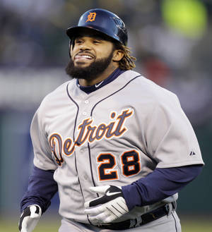 Photo -   Detroit Tigers' Prince Fielder returns to the dugout after Oakland Athletics' Coco Crisp made a catch at the top of the wall for the out on a ball hit by Fielder in the second inning of Game 3 of an American League division baseball series in Oakland, Calif., Tuesday, Oct. 9, 2012. (AP Photo/Ben Margot)