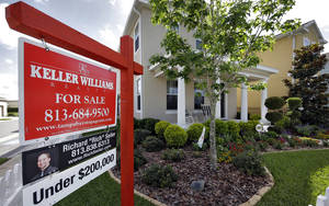 Photo - This May 14, 2014 photo shows a new home for sale in the Winthrop subdivision in Riverview, Fla. Freddie Mac reports on average U.S. mortgage rates for this week on Thursday, June 5, 2014. (AP Photo/Chris O'Meara)
