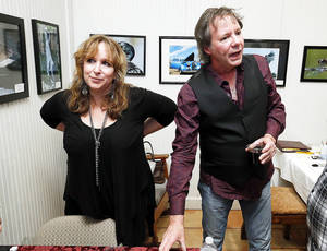 Singer/songwriter Gretchen Peters and her accompanist/husband, Barry Walsh, interact with audience members Sunday at a Winter Wind concert at the Santa Fe Depot in Norman. PHOTOs BY STEVE SISNEY, THE OKLAHOMAN