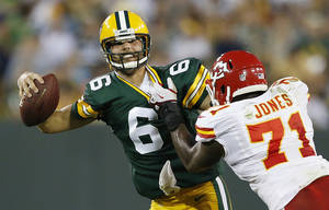 photo -   Kansas City Chiefs' Jeff Allen (71) pressures Green Bay Packers quarterback Graham Harrell (6) during the second half of an NFL preseason football game Thursday, Aug. 30, 2012, in Green Bay, Wis. (AP Photo/Tom Lynn)