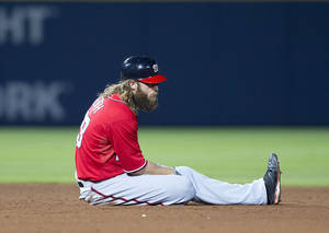 Photo - Washington Nationals right fielder Jayson Werth (28) sits on the field after being forced out at second base on a double play in the eighth of a baseball game  Sunday, Aug. 10, 2014 in Atlanta. Atlanta won 3-1.  (AP Photo/John Bazemore)
