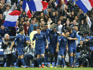 Photo - France's Franck Ribery, second right, is congratulated by teammates after scoring against Finland's during their 2014 World Cup Group I qualifying soccer match  at the Stade de France stadium in Saint Denis, north of Paris, France, Tuesday, Oct. 15, 2013. (AP Photo/Francois Mori)