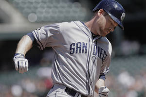 Photo -   San Diego Padres' Chase Headley, rounds third after hitting a two-run home run on a pitch by Colorado Rockies Jeff Francis during the first inning of a baseball game Sunday, Sept. 2, 2012 in Denver. (AP Photo/Barry Gutierrez)
