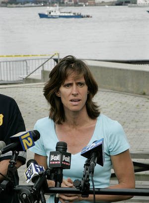 Photo - FILE - In this Saturday, Aug. 8, 2009 file photograph, Hoboken Mayor, Dawn Zimmer speaks to the media as she stands near the Hudson River in Hoboken, N.J. Zimmer, mayor of a New Jersey city that sustained severe flooding from Hurricane Sandy claims the Christie administration withheld millions of dollars in recovery grants because she refused to sign off on a politically connected development. MSNBC first reported her comments Saturday. (AP Photo/Mel Evans,file)