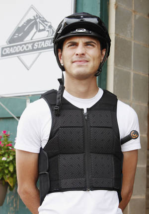 Photo - Jockey Chris Landeros outside one of the stables at Remington Park in Oklahoma City Thursday, Aug. 15, 2013.  Photo by Paul B. Southerland, The Oklahoman