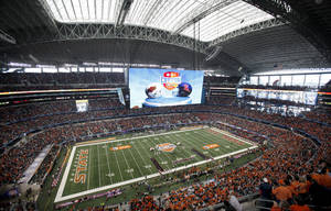 photo - Fans cheer before the Cotton Bowl Classic college football game between the Oklahoma State University Cowboys (OSU) and the Ole Miss Rebels at Cowboys Stadium in Arlington, Texas, Saturday, January 2, 2010. Photo by Sarah Phipps, The Oklahoman