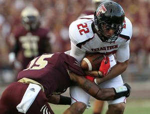 Photo -   Texas State's Jason McLean tries to bring down Texas Tech's Jace Amaro during their NCAA college football game in San Marcos, Texas, Saturday, Sept. 8, 2012. (AP Photo/Lubbock Avalanche-Journal,Stephen Spillman)