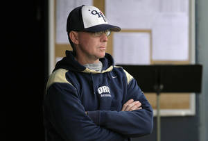 photo - ORU coach Rob Walton watches the Golden Eagles play Wichita State in Tulsa, OK Mar. 26, 2010. MICHAEL WYKE/Tulsa World ORG XMIT: DTI1003242012408509