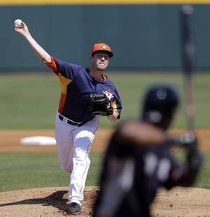photo - Houston Astros pitcher Lucas Harrell throws New York Yankees' Eduardo Nunez during the first inning of an exhibition spring training baseball game Thursday, Feb. 28, 2013, in Kissimmee, Fla. (AP Photo/David J. Phillip)