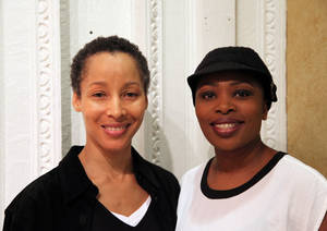 "Photo -   In this Nov. 8, 2012, photo, dancer Camille N. Brown, left, and singer Lindiwe Dlamini pose before a performance of ""The Lion King"" in New York. Both women have been in the ensemble of the Broadway hit show for its entire 15-year run. (AP Photo/Mark Kennedy)"