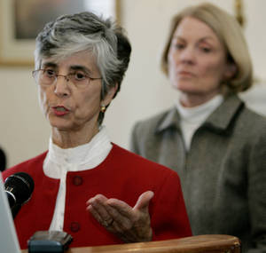 Photo - Odilia Dank, left, answers a question at a December 2005 news conference in Oklahoma City. <strong> - AP</strong>