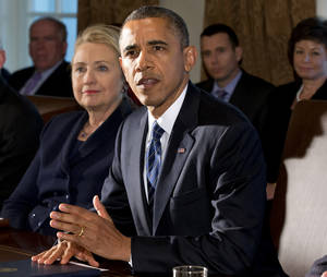 Photo - FILE - This Nov. 28, 2012 file photo shows then-Secretary of State Hillary Rodham Clinton listening as President Barack Obama speaks in the Cabinet Room at the White House in Washington. The White House confirmed that Hillary Clinton had lunch with President Obama Thursday. (AP Photo/Jacquelyn Martin, File)