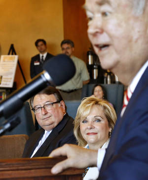 Photo - Gov. Mary Fallin, center,  was joined by University of Oklahoma President David Boren, right, at a news conference Monday morning, Sep. 23, 2013, to announce a $20.3 million federal grant to the OU Health Sciences Center in collaboration with Oklahoma Medical Research Foundation and other medical institutions across the state. At far left is Dr. M. Dewayne Andrews, provost of the OU Health Sciences Center,  and  executive dean of the OU College of Medicine. The grant targets medically underserved populations, especially in rural areas of Oklahoma. The five-year grant from the National Institutes of Health supports an Institutional development Award. Photo by Jim Beckel, The Oklahoman