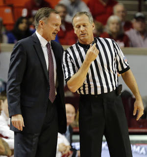 Photo - Oklahoma coach Lon Kruger has a talk with the official during the NCAA college basketball game between the University of Oklahoma Sooners (OU) and the University of Kansas (KU) Jayhawks at Lloyd Nobel Center in Norman,  Okla. on Wednesday, Jan. 8, 2014.   .Photo by Chris Landsberger, The Oklahoman