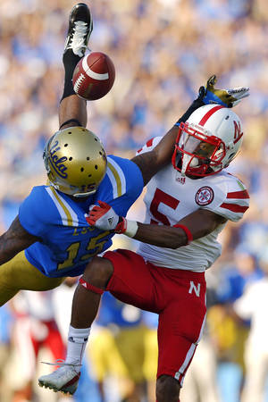 photo -   Nebraska cornerback Braylon Heard, right, breaks up a pass intended for UCLA wide receiver Devin Lucien during the first half of their NCAA college football game, Saturday, Sept. 8, 2012, in Pasadena, Calif. (AP Photo/Mark J. Terrill)  